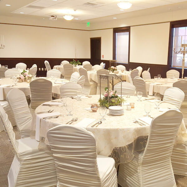 Ivory Spandex Chair Covers | Celebrations by Rent-All located in Sioux Center | Wedding Rental | Chair Covers For Rent