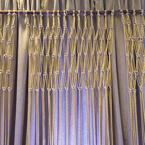 Macrame Backdrop | Celebrations by Rent-All located in Sioux Center | Wedding Rental | Backdrops For Rent