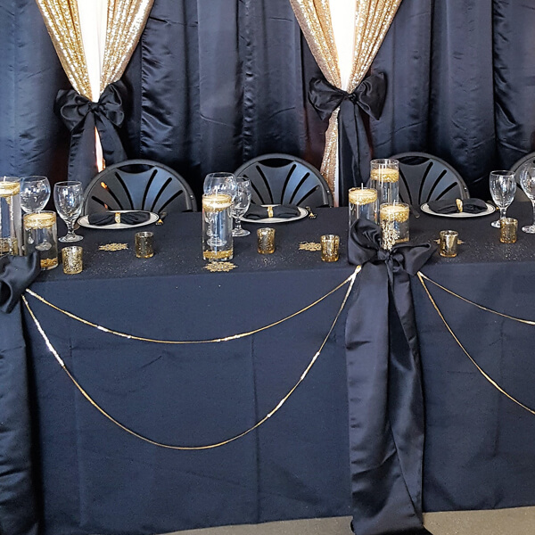 Black Poly Tablecloth | Celebrations by Rent-All located in Sioux Center | Wedding Rental | Tablecloths For Rent